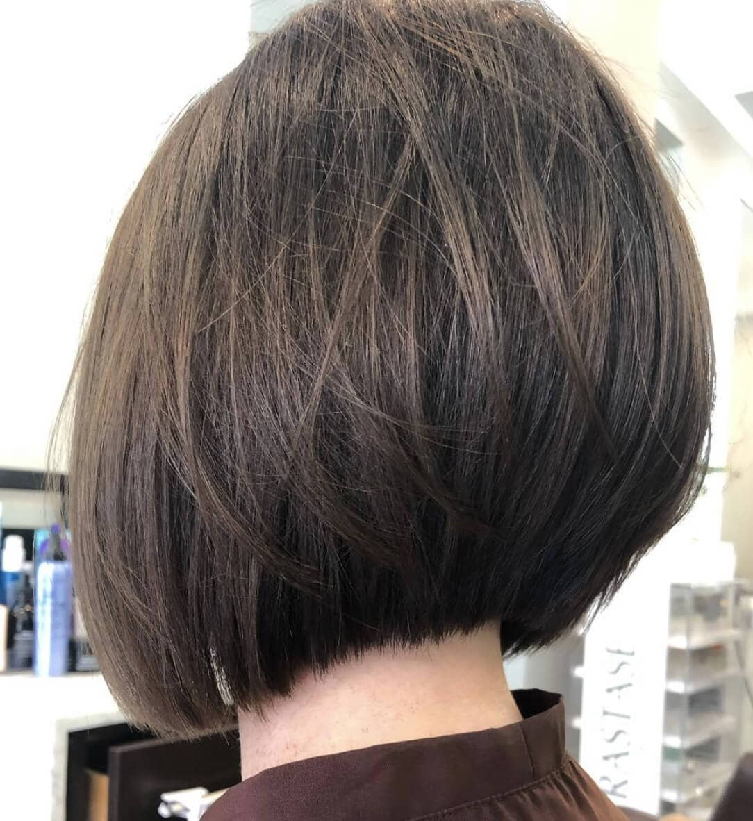 Rear headshot of short brunette bob haircut in Westchester salon