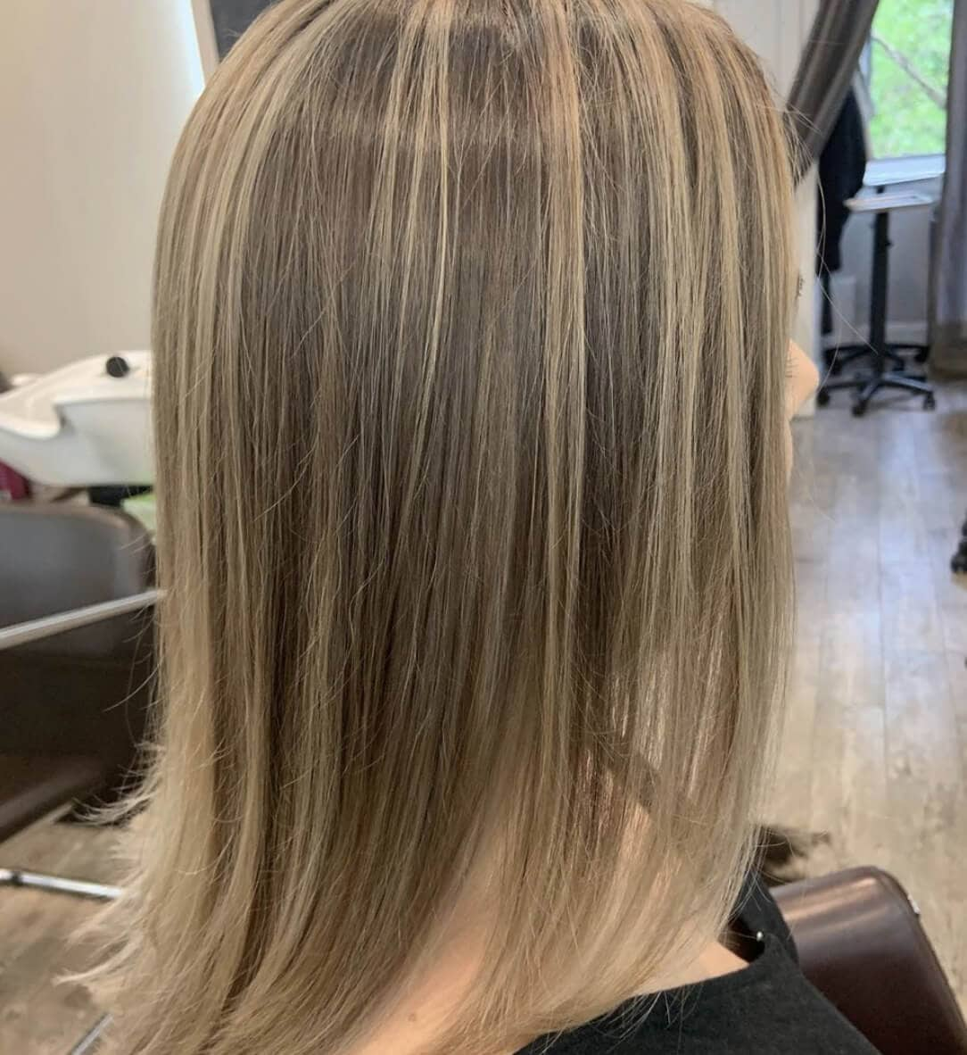 Rear headshot of long straight blonde hair in Westchester hair salon