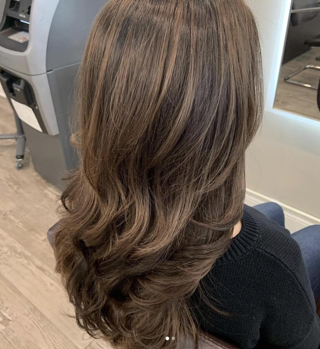 Rear headshot of long brunette wavy hair in Westchester salon